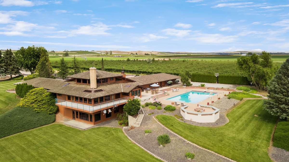 Start a whole new life on this 42-acre Columbia Valley wine country estate