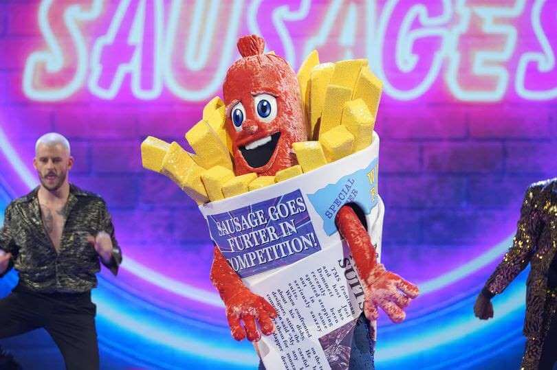 Who Is The Sausage On 'The Masked Singer' UK? Clues Decoded + Our Prediction